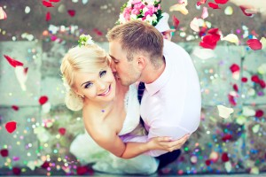Beautiful wedding couple , groom kisses the bride